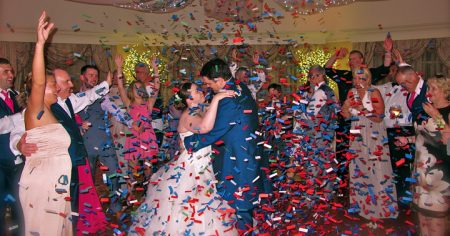 A confetti blast helps a wedding couple celebrate the last dance of the night with Orlando Wedding DJ Chuck Johnson