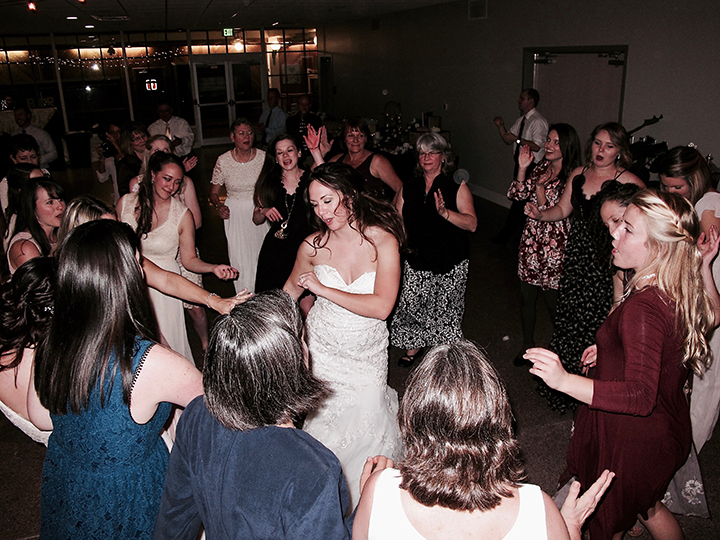 The Bride dancing with her wedding guests during the reception