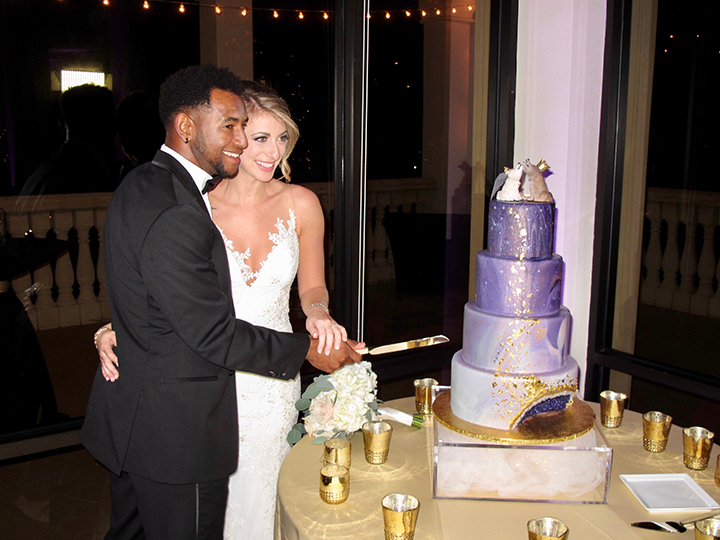 Cutting the cake at the wedding reception