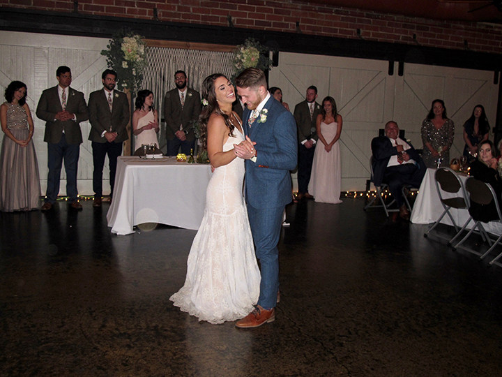Bride and Groom take the dance floor for the First Dance as husband and wife