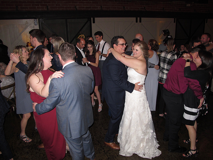 Bride and Groom dancing with guests at their reception