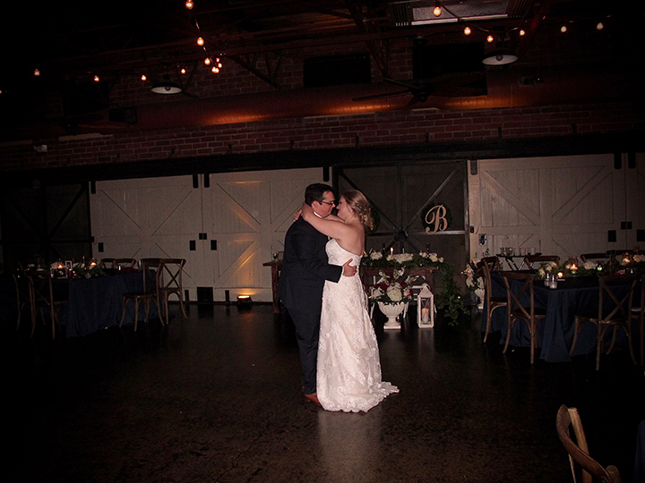 Bride and groom sharing the farewell dance at their wedding reception