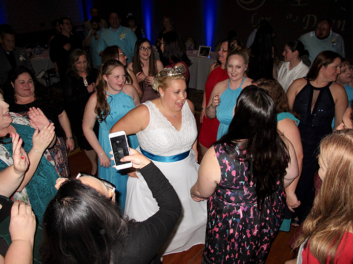 The bride dancing with her guests as DJ Chuck Johnson spins tunes at her wedding reception