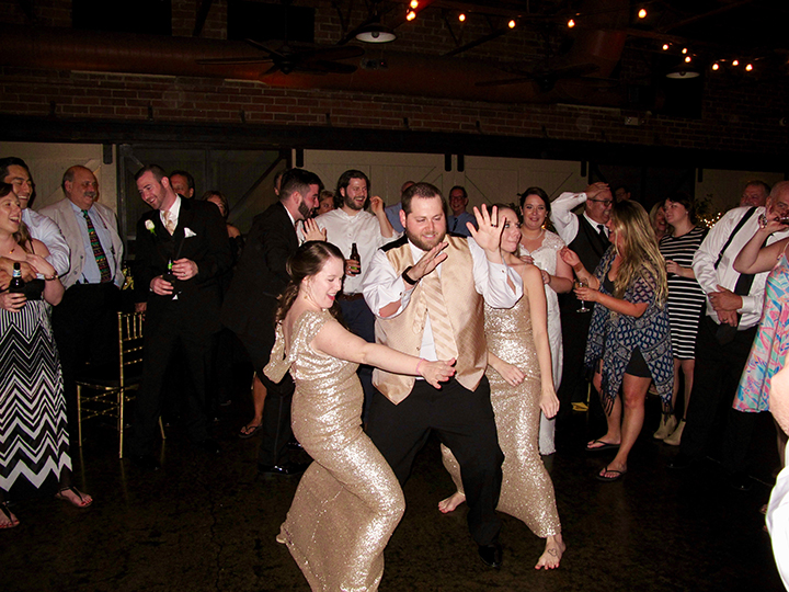 The Groom dances with friends and family during the reception.