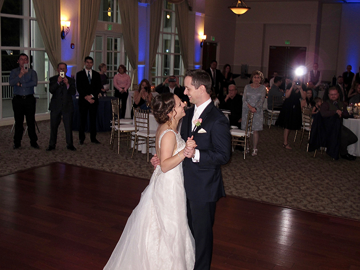 A Bride and Groom share the dance floor for their First Dance of the Reception.