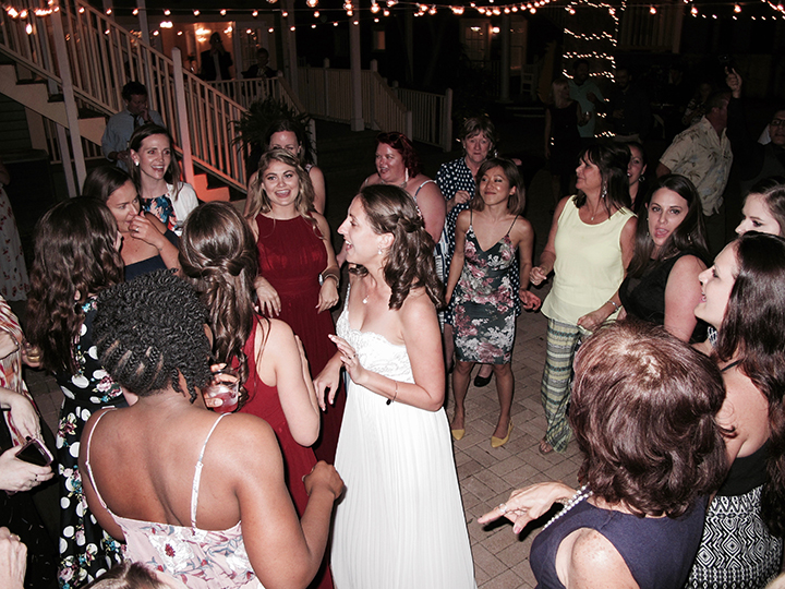 The bride on the dance floor with DJ Chuck Johnson playing music at the reception.