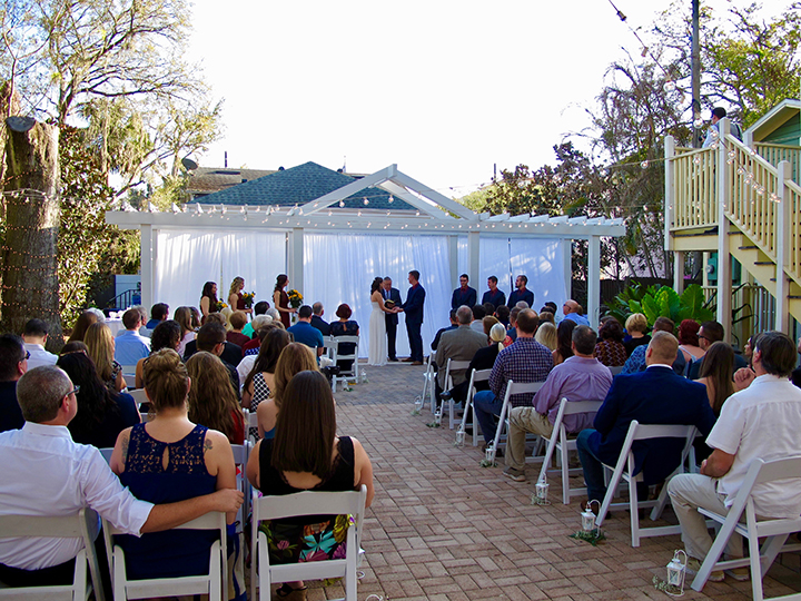 An outdoor wedding ceremony in a downtown Orlando Bed & Breakfast courtyard.