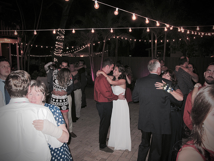 The wedding couple dances with their guests at the Reception at the Veranda at Thornton Park.