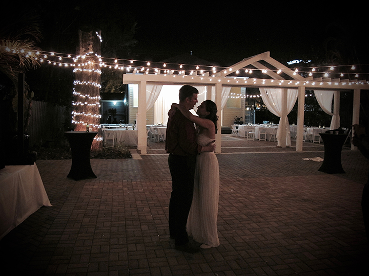 The couple dances to their farewell song at their wedding under the stars.