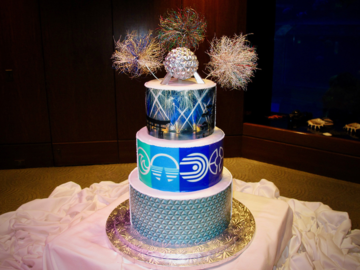 This Wedding cake depicts Epcot attractions and fireworks at the Living Seas Salon