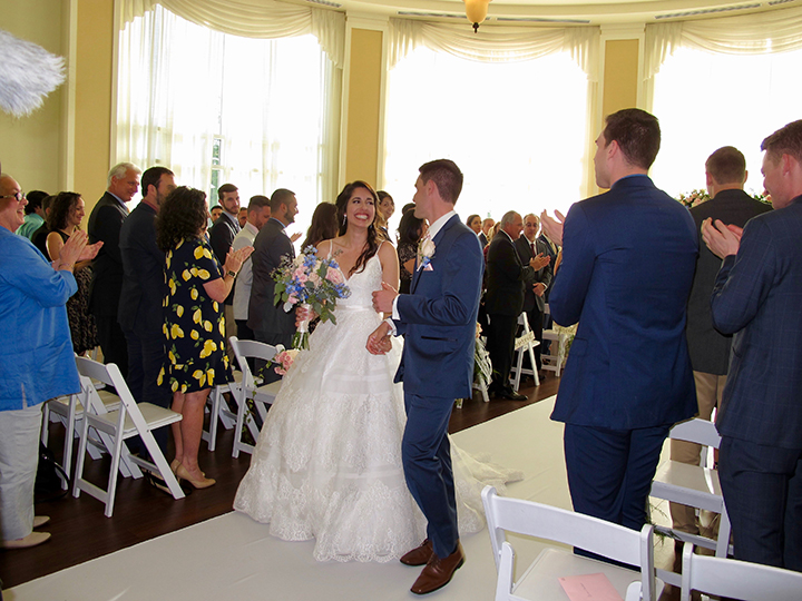 The Wedding Couple walk down the aisle after exchanging their vows in the Rotunda.
