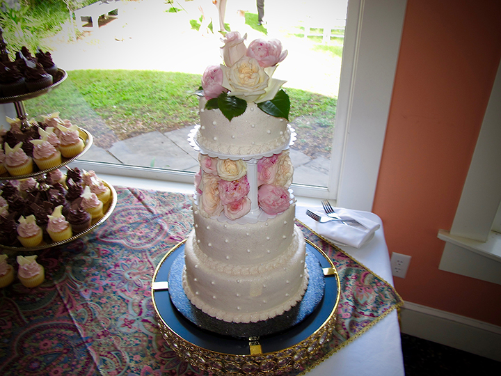 The wedding cake in front of a picture window at the Historic Lakeside Inn.