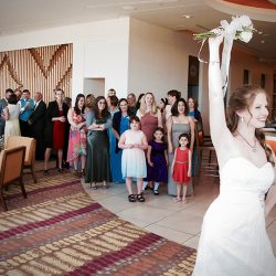 The bride is tossing the bouquet; Orlando Wedding DJ Chuck can help with all of the events at your reception.