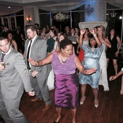 Guests are dancing at the reception from music provided by Orlando Wedding DJ Chuck Johnson, Classic Disc Jockeys.