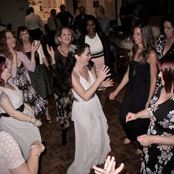 The bride is dancing with family and friends to music from Orlando Wedding DJs Chuck Johnson