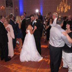 The bride and groom are dancing with family to music from Orlando Wedding DJ Chuck Johnson.