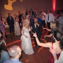 The Bride and Groom are having fun with wedding guests to music for Orlando DJs Chuck Johnson