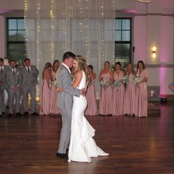 The wedding couple share their First Dance as husband and wife on the dance floor.