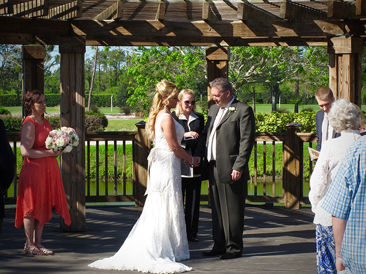 The wedding couple get married at an outdoor ceremony at the Marriott World Center Orlando.