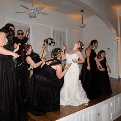 The bride and wedding party jam out to some great tunes provided by Orlando Wedding DJ Chuck Johnson.