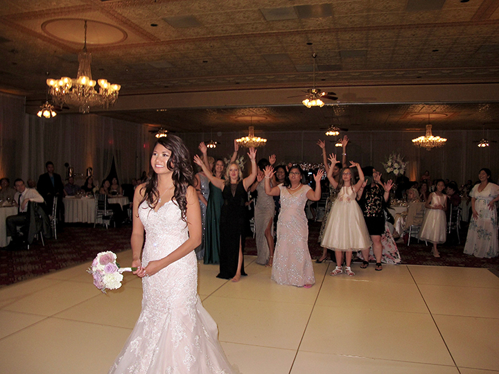 The Bride is about to toss the bouquet at her wedding reception in Downtown Orlando.