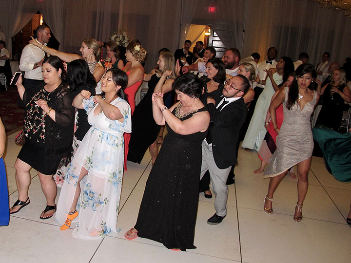 Wedding guests are having fun dancing the Wobble with Orlando DJ Chuck Johnson from Classic Disc Jockeys.