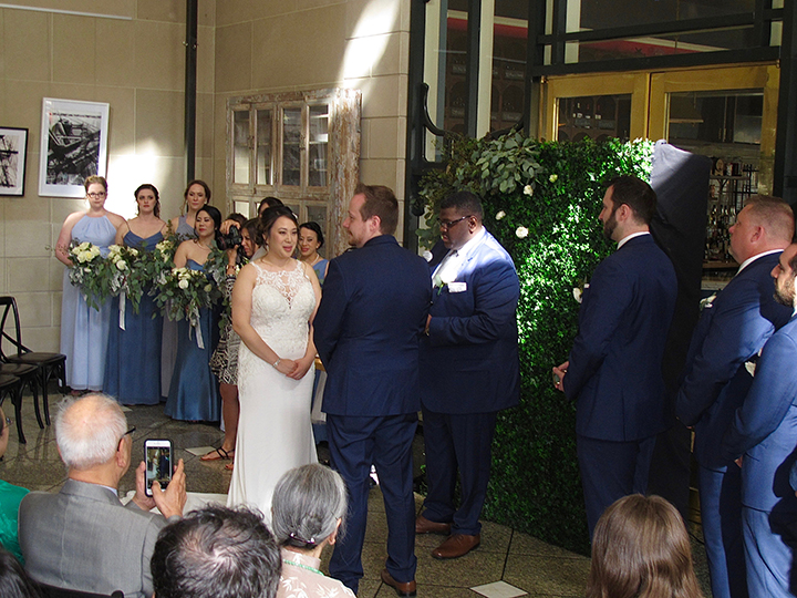 The newlywed couple exchange vows at their wedding ceremony at the Dovecote Brasserie in Downtown Orlando.