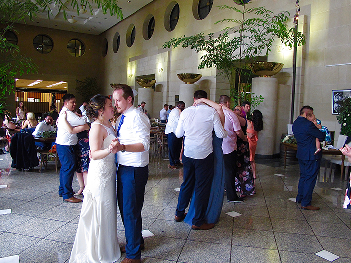 Wedding guests dancing at the reception at Dovecote Brasserie in the Bank of America Building in Orlando.