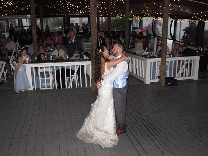 The bride and groom celebrate their Paradise Cove wedding reception on the dance floor.