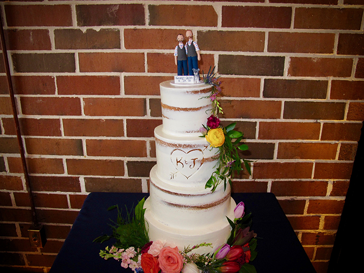 The wedding cake is displayed at the reception at the Winter Park Farmer's Market.