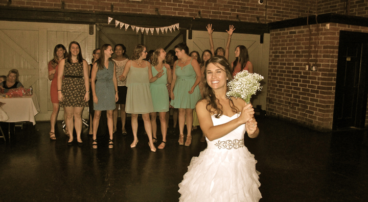 The Winter Park Farmer's Market is the perfect backdrop for all your wedding traditions, including this bouquet toss.