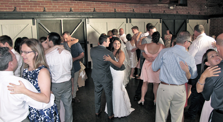 The wedding couple share the dance floor with family and friends, and Orlando DJ Chuck Johnson.