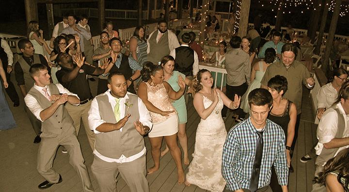 Wedding guests do the Wobble with Orlando Wedding DJ Chuck Johnson.