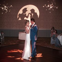 A bride and groom share their first dance together at their reception with Orlando Wedding DJ Chuck Johnson.