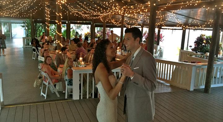 A couple share their First Dance of the wedding reception with Orlando Wedding DJ Chuck Johnson.