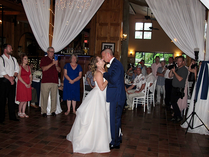 A bride and groom share the dance floor at their wedding reception with Orlando DJ Chuck Johnson.