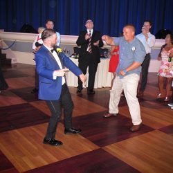 The groom has some fun with his wedding guests at Atlantic Dance Hall with Orlando DJ Chuck Johnson.