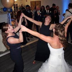 The bride and her bridesmaids dance at the reception at the Hyatt Grand Cypress Lakeside Casita.