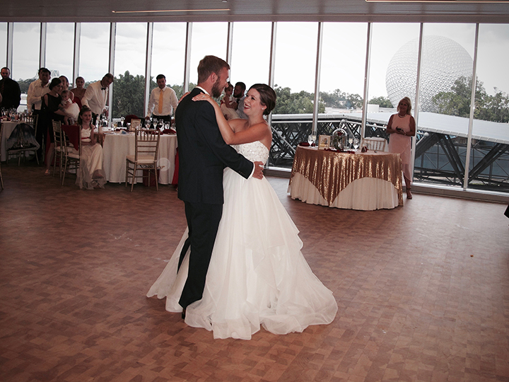 The Bride and Groom in their First Dance at the GM Lounge in Epcot with Orlando Wedding DJ Chuck Johnson.