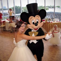 A bride dances with Mickey Mouse at her GM lounge wedding in Epcot with Orlando DJ Chuck Johnson.