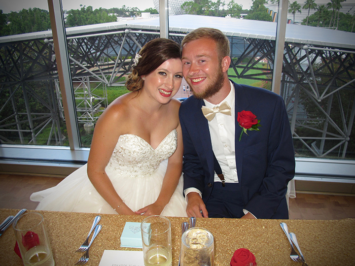 The wedding couple at their sweetheart table at their reception at the GM Lounge with Orlando DJ Chuck Johnson.