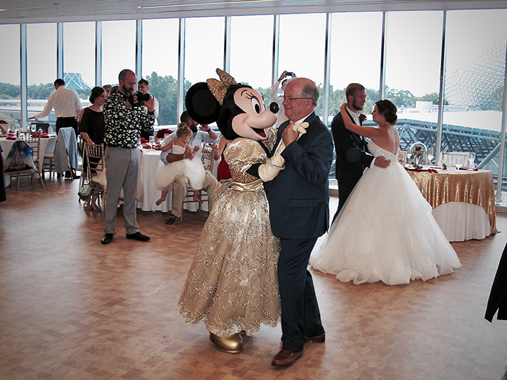 Minnie Mouse dances with wedding guests at the Test Track VIP GM Lounge with Orlando DJ Chuck Johnson.