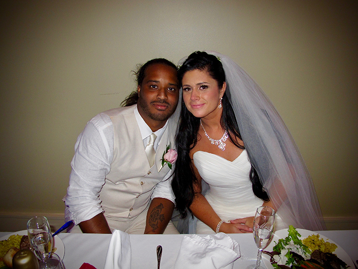 The wedding couple at their sweetheart table at the Cocoa Beach Oceanfront Hotel.