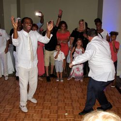 Groom dancing with his friends and family at the Hilton Cocoa Beach Oceanfront with Orlando Wedding DJ Chuck Johnson