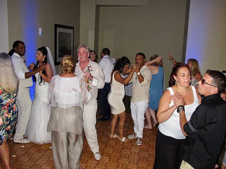 Wedding guests enjoy the reception at the Hilton Cocoa Beach Oceanfront Hotel