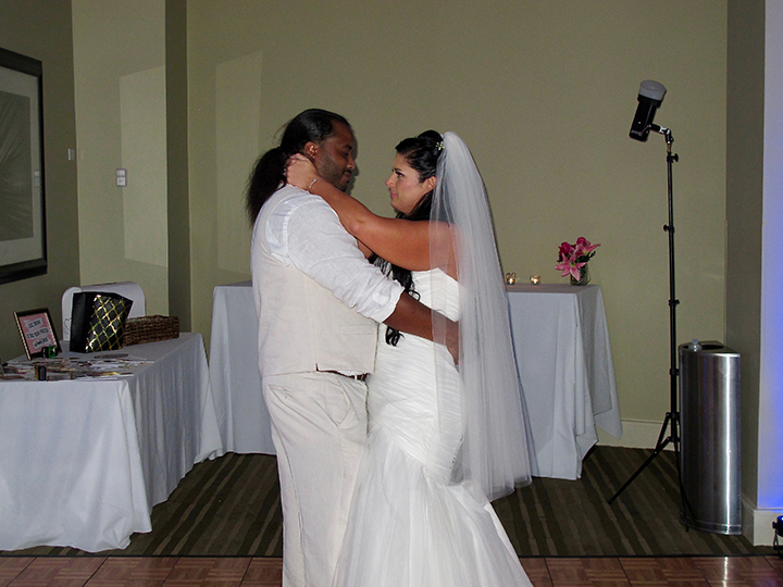The wedding couple share their first dance together with Cocoa Beach Wedding DJ Chuck Johnson