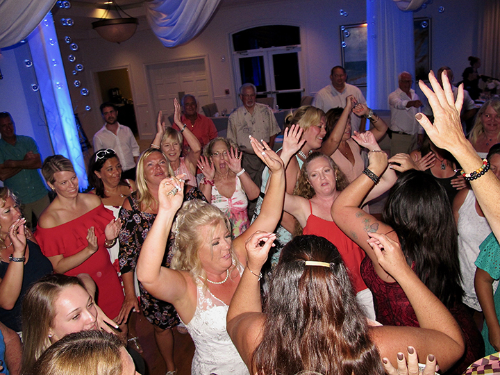The bride takes to the dance floor during her vow renewal with Palm Coast DJ Chuck Johnson.