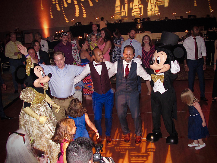 Mickey and Minnie celebrate with wedding guests at this gay-friendly wedding at Walt Disney World.