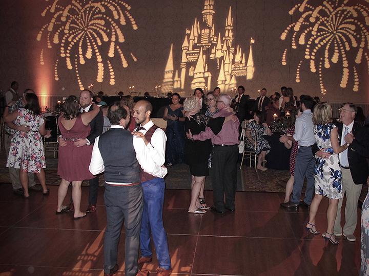 Orlando same-sex couple dance their first dance of their wedding with Orlando DJ Chuck Johnson.