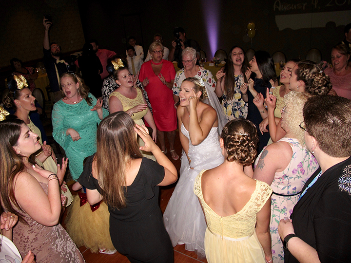 A bride having fun with her wedding guests and Orlando DJ Chuck Johnson
